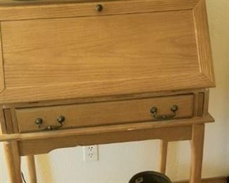Small  Oak desk with writing surface and filing cubby holes