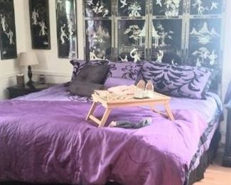 Awesome bed with large Asian headboard