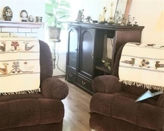 Two comfortable recliners and several vintage Mexican rugs