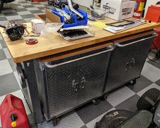 Rolling diamond plate tool cabinet work bench