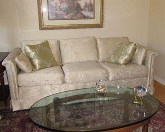 Damask sofa and glass top coffee table