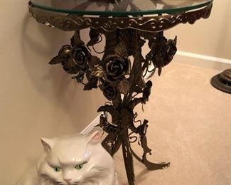 unique metal table and a cat you don't have to feed