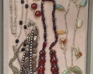 Jewelry: sterling chains & pendants (one by Lori Bonn), freshwater pearl & jasper necklace, amber necklace, necklace with carved jade charms, Mexican sterling brooch/pendant & more