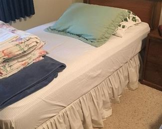 Twin bed: mattress (like new/clean), box spring, pillows and bedding all included. Two matching beds available.
