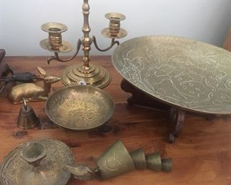 Collection of brass candlesticks and décor.