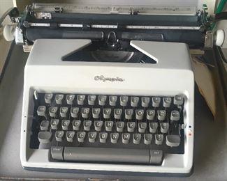 Vintage portable Olympia typewriter (needs servicing).
