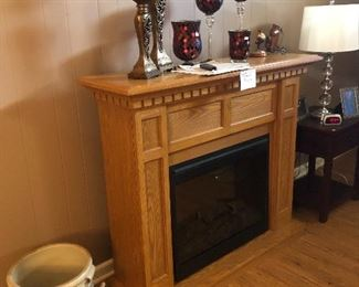 House 1: Antique crock and portable fireplace with remote
