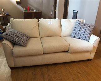 House 1: Like-new ivory couch