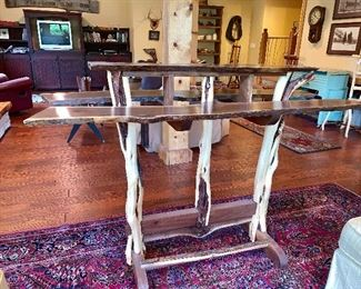 This picture does not capture just how beautifully made this handmade wine table is. The 3 top pieces are cut from the same piece of wood and legs are made from trees branches