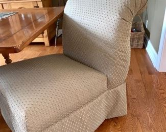 1 of 2 matching upholstered armless chairs