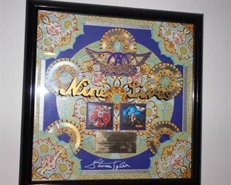 Aerosmith band signed plaque
