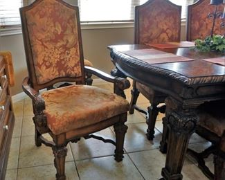 Impressive dining table, chairs, and china cabinet