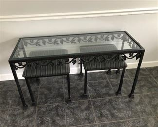 Glass table, seats -- matches large mirror