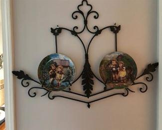 Collector plates on iron wall display