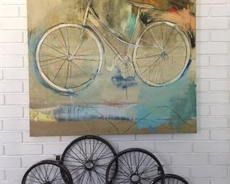 Bicycle wall art and matching wheel wall art.