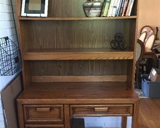 Excellent wooden desk and above storage unit.