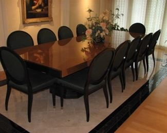 Large Lucien Rollin dining or conference room table.  Easily seats 12.   There are 2 additional leaves that can be added to the ends, extending the table further.  The leaves are in a custom wood case.  Includes table pads and table cloth.