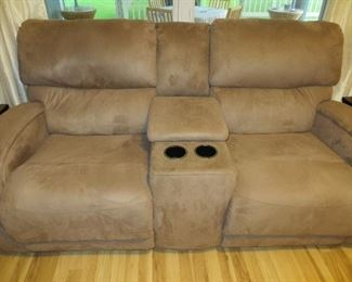 Dual power reclining sofa with console.