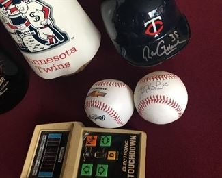 Signed Ron Gardenhire Mini Twins Helmet and a signed LaTroy Hawkins Ball
