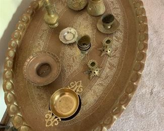 Close view of table top with vintage brass items