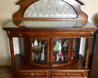 Antique sideboard/server with curved glass display, 3 drawers, crystal and brass hardware, brass lion head ornamental detail, and etched glass backsplash