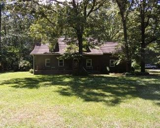 Beautiful 1 1/2 story home on 3 acre lot with outbuilding