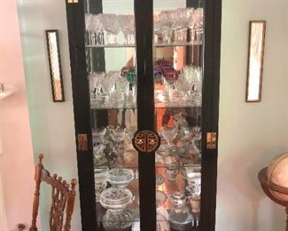 Asian inspired curio cabinet guarded by two fierce jet black cats on top