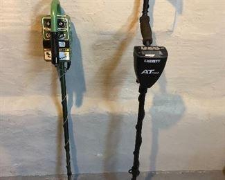 Metal detectors with accompanying accessories.  Garrett