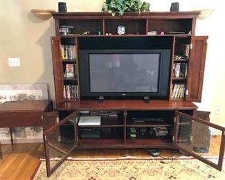 Entertainment center w/DVDs, CDs, flatscreen TV, Samsung DVD player, speakers