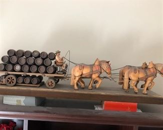 Vintage Anri horse-drawn beer cart with driver and a full load of barrels
