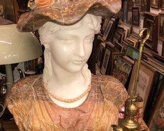life size marble bust of woman, with tri color marble.