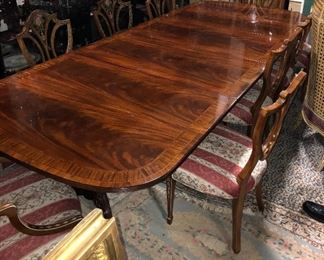 this is a banquet table with 12 Adams hand painted Shield back chairs, a silver chest, a HEPPLEWHTE double curved sideboard with string inlay, pair of ADAMS hand painted floral small sideboards and a drop dead banded inlaid pediment 4door breakfront