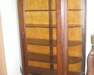 Exceptional five shelf oak curved glass antique china cabinet.