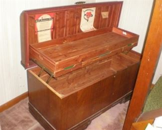 Exceptional antique waterfall front cedar chest with inside shelf.