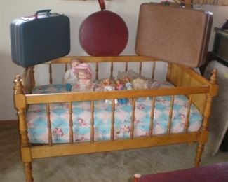 Vintage toddler bed with mattress, would be idea to display a doll or bear collection. Three nice vintage suitcases, including a Mid Century Modern round suitcase.