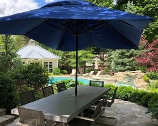 Cement formed Dining Table with 8 arm chairs and blue umbrella - Purchased from Teak Outlet