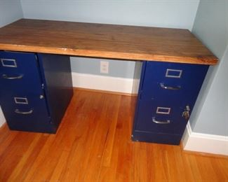 TWO FILE CABINETS USED AS LEGS TO FORM A DESK