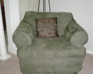 Chair is beige, but has Green Fitted Cover on it