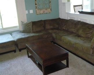 Corner Sofa with Ottoman. Needs Cleaning. Coffee Table has slide out Storage Drawer