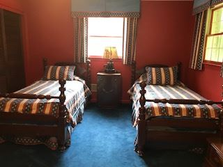 Pair of cannonball post twin beds with patriotic bed covers