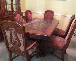 Double pedestal carved wood dining table has 2 leaves and 6 chairs