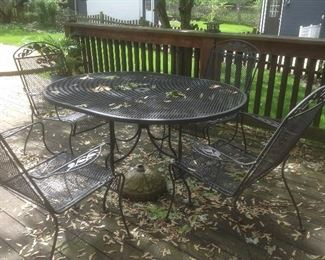 Wrought iron table with 4 chairs....presale $125 also has umbrella and umbrella stand