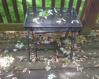Two nesting wrought iron tables.