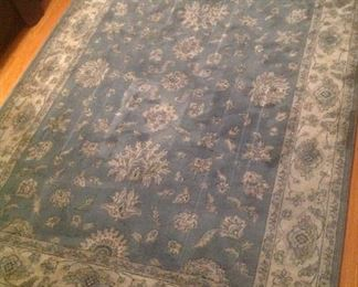 5x7 rug with colors of blue and beige