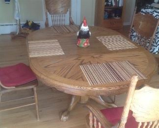 """Oak dining room set with six chairs. Measures 46"""" round plus 24"""" leaf as shown.   4 side plus two arm chairs.  Presale $250"""