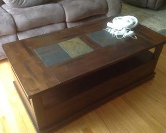 """Three piece coffee/end table set.  Coffee table measures 48"""" long x 24"""" wide x 19"""" tall.  Wood with slate insets"""