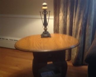 """Oak end table that fold down ...26"""" long x 18"""" w x 24"""" tall.  Becomes 32"""" wide with sides up."""