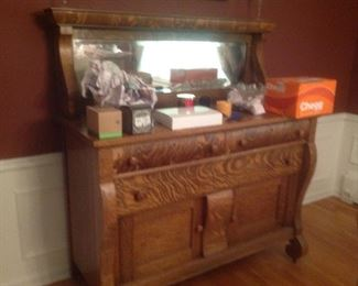 """Antique buffet with mirror....55"""" wide x 24"""" deep x 59"""" high.  Some veneer has peeled on a drawer.  Presale  is $95."""