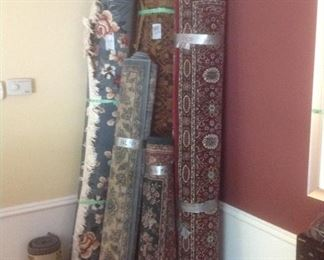 Multiple colors and sizes of rugs