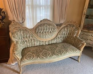Victorian sofa has two matching chairs